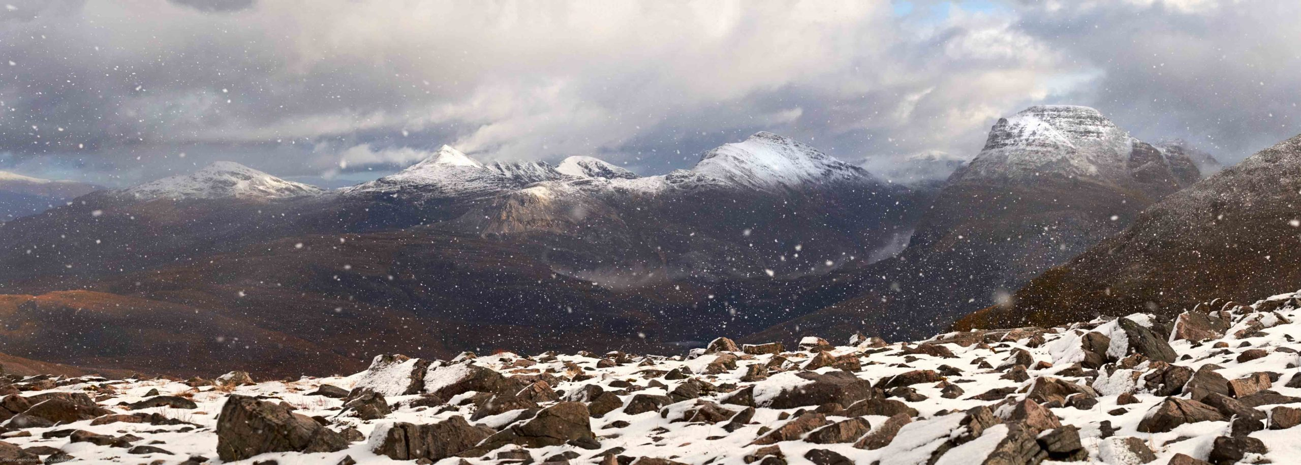 A panoramic view of Beinn Liath Mhor, Sgorr Ruad and Maol Chean Dearg in winter. Scottish Highlands